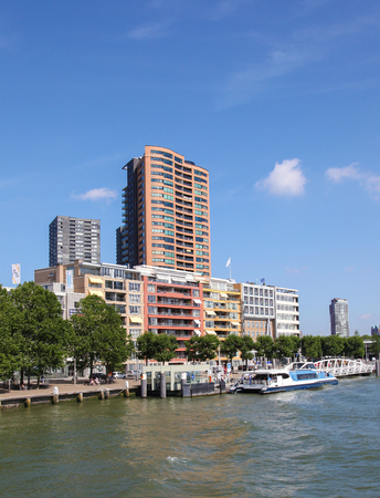 maas: ROTTERDAM, THE NETHERLANDS - AUGUST 9, 2015: Residential buildings by the Nieuwe Maas in the center of Rotterdam, South Holland, The Netherlands. Editorial