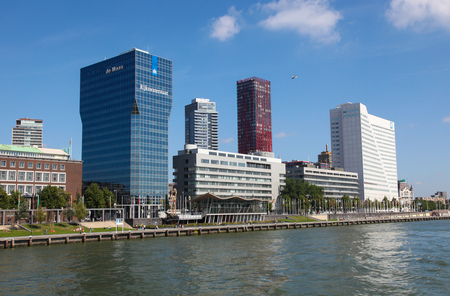 public works: ROTTERDAM, THE NETHERLANDS - AUGUST 9, 2015: Skyscrapers in Rotterdam, by the Nieuwe Maas in South Holland, The Netherlands. The building on the left is the office building of Rijkswaterstaat, government agency of public works and water management. Editorial
