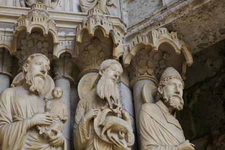 martyr: Statues of Catholic Saints at the Cathedral of Our Lady of Chartres, a medieval Catholic cathedral in Chartres, France, about 80 kilometers southwest of Paris. Stock Photo