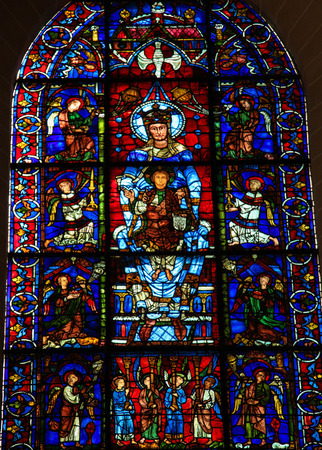 chartres: CHARTRES, FRANCE - JULY 21, 2015: Famous stained glass window Notre Dame de la Belle Verriere or The Blue Virgin (12th Century) in the Cathedral of Our Lady of Chartres, France.