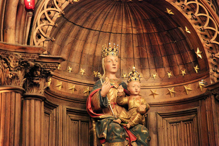 polychrome: CHARTRES, FRANCE - JULY 21, 2015:  Notre Dame du Pilier or Our Lady of the Pillar Statue (16th Century), a polychrome statue in Cathedral of Our Lady of Chartres, France.