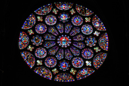 CHARTRES, FRANCE - JULY 21, 2015: South transept Rose Window (12th Century) in the Cathedral of Our Lady of Chartres, France. Editorial