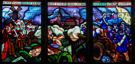 17th: MORTAGNE-AU-PERCHE, FRANCE - JULY 20, 2015: Stained Glass depicting the Departure of Pierre Boucher at La Rochelle for Quebec (17th Century) in the Notre Dame church of Mortagne, Perche, France
