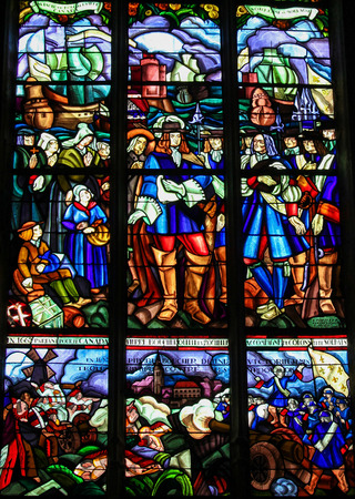 settler: MORTAGNE-AU-PERCHE, FRANCE - JULY 20, 2015: Stained Glass depicting the Departure of Pierre Boucher at La Rochelle for Quebec (17th Century) in the Notre Dame church of Mortagne, Perche, France