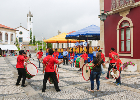folkloristic: PAREDES DE COURA, PORTUGAL - AUGUST 8, 2014: Folkloristic drum band in the center of Paredes de Coura in Norte region, Portugal