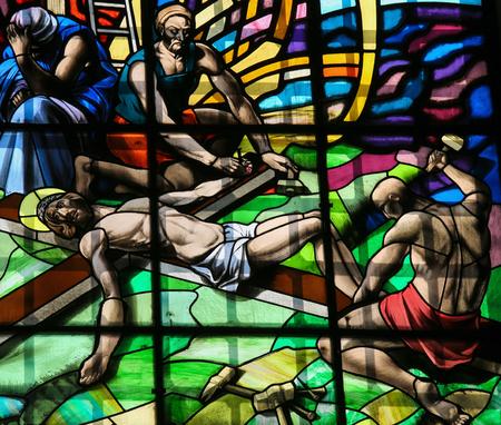 guimaraes: GUIMARAES, PORTUGAL - AUGUST 7, 2014: Stained glass window depicting The Crucifixion of Jesus in the Santos Passos church in Guimaraes, Portugal. Editorial