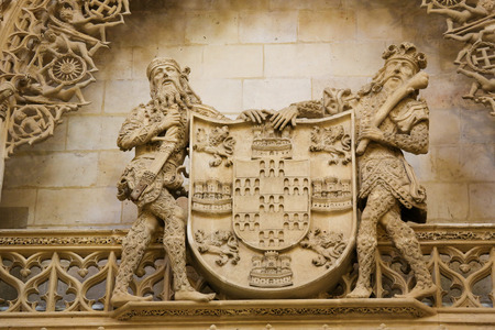 castille: BURGOS, SPAIN - AUGUST 13, 2014: Statues holding a shield at the Cathedral of Burgos, Castille, Spain