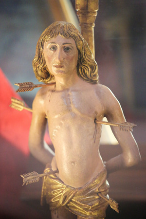 castille: BURGOS, SPAIN - AUGUST 13, 2014: Martyrdom of Saint Sebastian, medieval statue in the Cathedral of Burgos, Castille, Spain Editorial