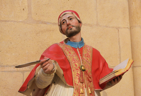 castille: BURGOS, SPAIN - AUGUST 13, 2014: Polycrhome Statue of a Theologian in the Cathedral of Burgos, Castille, Spain