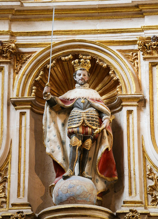 habsburg: BURGOS, SPAIN - AUGUST 13, 2014: Polychrome Statue of Spanish Emperor Carlos I of the House of Habsburg, standing on a globe, in the Cathedral of Burgos, Castille, Spain