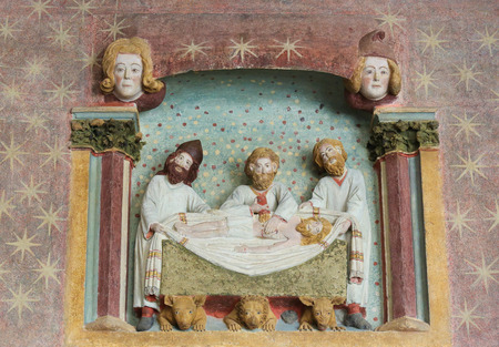 castille: BURGOS, SPAIN - AUGUST 13, 2014: Painted sculpture of Three Men and the Body of Christ in the Cathedral of Burgos, Castille, Spain