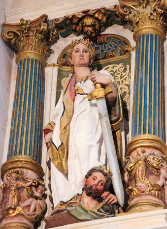 castille: BURGOS, SPAIN - AUGUST 13, 2014: Polychrome Statue depicting Judith with the head of Holofernes in the Cathedral of Burgos, Castille, Spain Editorial