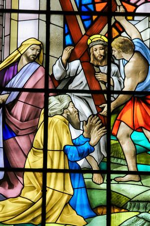guimaraes: GUIMARAES, PORTUGAL - AUGUST 7, 2014: Stained glass window depicting Jesus on the Via Dolorosa in the Santos Passos church in Guimaraes, Portugal. Editorial