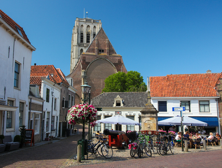 catherine: BRIELLE, THE NETHERLANDS - AUGUST 8, 2015: Church of Saint Catherine and Old Houses in Brielle, also known as Den Briel, in South Holland, The Netherlands