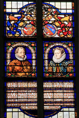 orange nassau: BRIELLE, THE NETHERLANDS - AUGUST 8, 2015: Stained glass window depicting William I, Prince of Orange, and his wife Charlotte of Bourbon, whose marriage took place in 1575 in the church of Brielle. Editorial