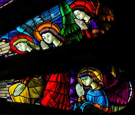 guimaraes: GUIMARAES, PORTUGAL - AUGUST 7, 2014: Stained glass window depicting angels in the Sanctuary of the Rock (Santuario da Penha) in Guimaraes, Portugal.