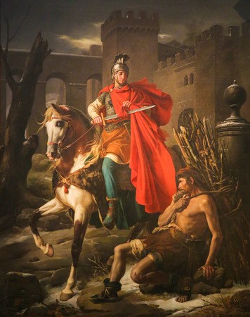 Painting depicting Saint Martin of Tours cuting a piece of his cloak in the Cathedral of Tours, France. Editorial