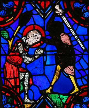 martyr: Stained glass window depicting the execution of a martyr in the Saint Gatien Cathedral of Tours, France.