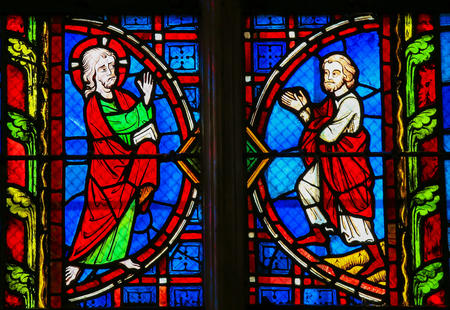 the believer: Stained glass window depicting Jesus and a Believer in the Cathedral of Tours, France.