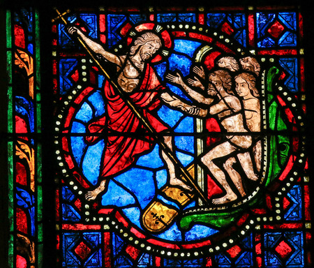 Stained glass window depicting Jesus Christ saving mankind in the Cathedral of Tours, France.