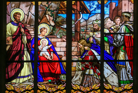 Mother Mary: Stained glass window depicting the Epiphany, the Visit of the Three Kings in Bethlehem, in the Cathedral of Tours, France. Editorial