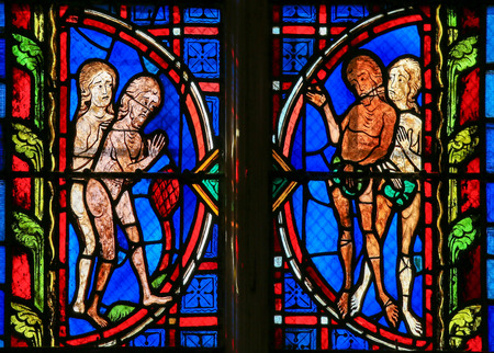 adam and eve: Stained glass window depicting Adam and Eve in the Cathedral of Tours, France.