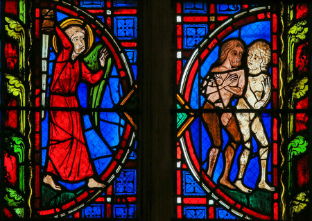 garden of eden: Stained glass window depicting Adam and Eve expelled from Paradise in the Cathedral of Tours, France.