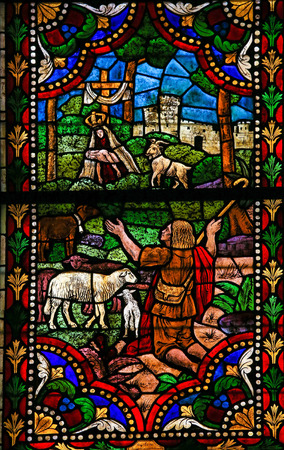 Mother Mary: LEON, SPAIN - AUGUST 12, 2014: Stained Glass window depicting the Apparition of Mother Mary and Jesus to a Shepherd in the Cathedral of Leon in Castile and Leon, Spain.