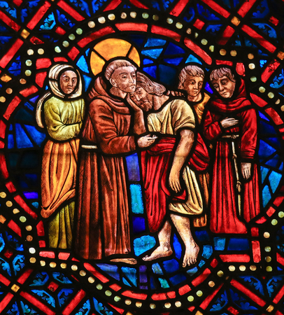 castile leon: LEON, SPAIN - AUGUST 12, 2014: Stained Glass window depicting a Christian Saint hugging Christ in the Cathedral of Leon in Castile and Leon, Spain.
