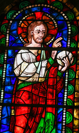new testament: LEON, SPAIN - JULY 17, 2014: Stained glass window depicting Jesus Christ blessing the Bread in the Basilica of San Isidoro in Leon, Castille and Leon, Spain. Editorial