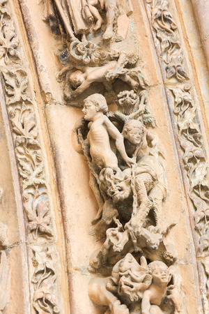 castile and leon: LEON, SPAIN - AUGUST 12, 2014: Sculptures of People and Devils in Hell in the Cathedral of Leon in Castile and Leon, Spain. Editorial