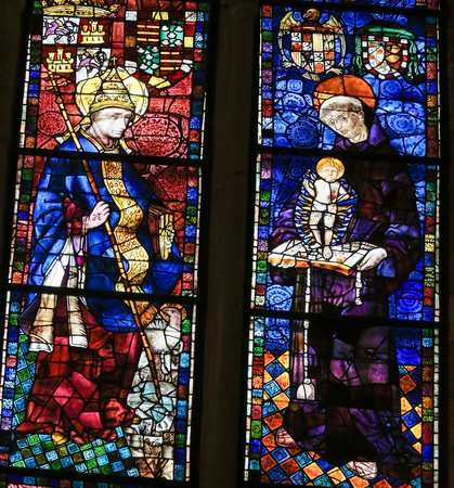 clement: LEON, SPAIN - AUGUST 12, 2014: Stained Glass window depicting Saint Clement of Rome and Saint Anthony of Padua in the Cathedral of Leon in Castile and Leon, Spain.