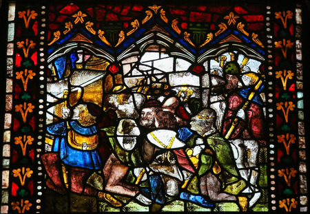 the believer: LEON, SPAIN - AUGUST 12, 2014: Stained Glass window depicting Medieval figures in the Cathedral of Leon in Castile and Leon, Spain.