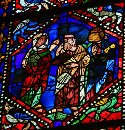 Mother Mary: LEON, SPAIN - AUGUST 12, 2014: Stained Glass window depicting Mother Mary blessing a Saint in the Cathedral of Leon in Castile and Leon, Spain.