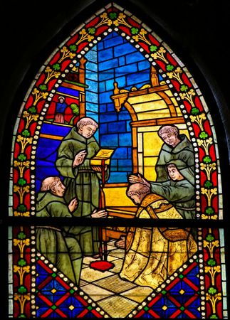 friar: LEON, SPAIN - JULY 17, 2014: Stained glass window depicting a Catholic Saint and monks with a box that is leaking the Blood of Christ in the cathedral of Leon, Castille and Leon, Spain. Editorial