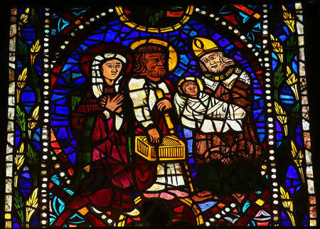 castille: LEON, SPAIN - JULY 17, 2014: Stained glass window depicting Simeon the God-receiver, Joseph, Mother Mary and the Child Jesus in the cathedral of Leon, Castille and Leon, Spain.