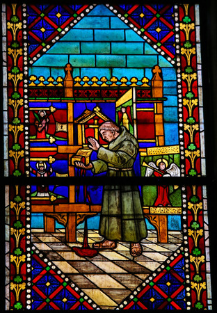 castille: LEON, SPAIN - JULY 17, 2014: Stained glass window depicting a Catholic Saint and monks with a box that is leaking the Blood of Christ in the cathedral of Leon, Castille and Leon, Spain. Editorial