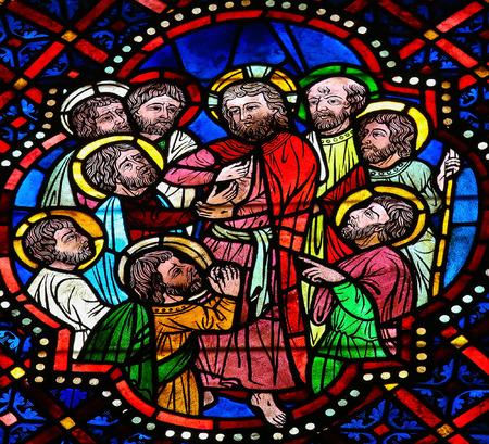 depicted: LEON, SPAIN - JULY 17, 2014: Stained glass window depicting Jesus and the apostles in the cathedral of Leon, Castille and Leon, Spain. The episode of Thomas the Apostle touching Jesus wound is depicted.