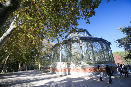 parque del buen retiro: MADRID, SPAIN - NOVEMBER 14, 2015: Palacio de Cristal (Crystal Palace), built in 1887 in the Buen Retiro Park, one of the main attractions of Madrid, Spain.
