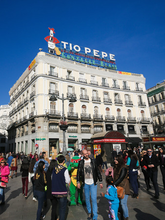 MADRID, SPAIN - NOVEMBER 14, 2015: Famous Tio Pepe Advertisement at the Puerta del Sol, one of the best known and busiest places in Madrid, Spain Editorial