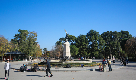 fallen angel: MADRID, SPAIN - NOVEMBER 14, 2015: Fuente del Angel Caido (Fountain of the Fallen Angel) in the Buen Retiro Park, one of the main attractions of Madrid, Spain.
