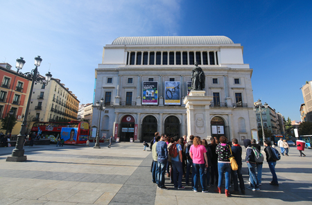 isabel: MADRID, SPAIN - NOVEMBER 14, 2015: Opera of Madrid or Teatro Real and Statue of Queen Isabel II at the Plaza de Isabel II in Madrid, Spain