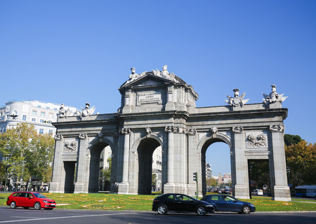 neoclassical: MADRID, SPAIN - NOVEMBER 14, 2015: The Puerta de Alcala (Alcala Gate) is a Neo-classical monument in the Plaza de la Independencia in Madrid, Spain.