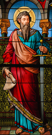 STOCKHOLM, SWEDEN - APRIL 16, 2010: Saint Paul the Apostle. Stained glass window in the German Church in Gamla Stan, Stockholm.
