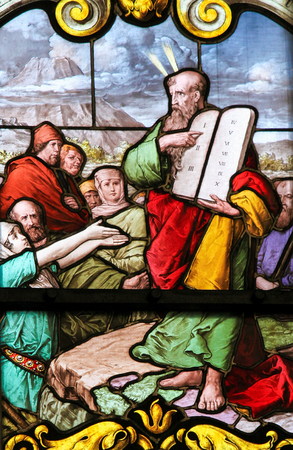 STOCKHOLM, SWEDEN - APRIL 16, 2010: Stained glass window depicting Moses with the Stone Tablets in Saint James's Church in Stockholm, Sweden.