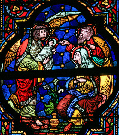 angel gabriel: DINANT, BELGIUM - OCTOBER 16, 2011 Stained glass window depicting Joseph, Mary, Gabriel and Jesus in the Notre Dame church in Dinant, Belgium