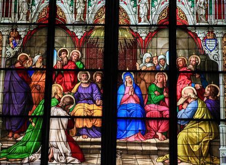COLOGNE, GERMANY - APRIL 21, 2010: Stained glass church window depicting Pentecost in the Dom of Cologne, Germany.