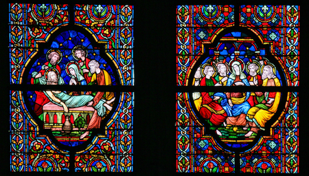 pentecost: DINANT, BELGIUM - OCTOBER 16, 2011 Stained glass window depicting Jesus laid in His tomb and Mother Mary and the Apostles at Pentecost, in the Notre Dame church in Dinant, Belgium