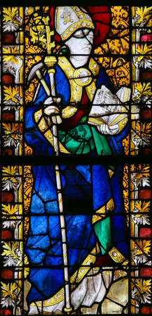 confessor: ROUEN, FRANCE - FEBRUARY 10, 2013: Saint Eligius on a stained glass in the cathedral of Rouen, France. Saint Eligius is the patron saint of horses, goldsmiths and coin collectors Editorial