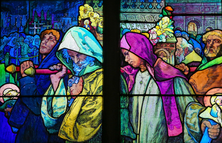 theologian: PRAGUE, CZECH REPUBLIC - APRIL 2, 2016: Stained Glass window in St. Vitus Cathedral, Prague, designed by Alphonse Mucha, depicting Saint Methodius carrying the casket of Saint Cyril.
